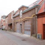 Verbouwing voormalige stallen tot appartementen