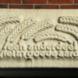 Gevelsteen met korenaren en inscriptie - Wladimir de Vries